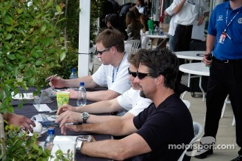 Buddy Lazier, Marco Andretti, and Michael Andretti sign