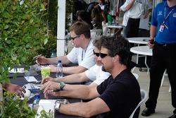 Buddy Lazier, Marco Andretti, and Michael Andretti sign