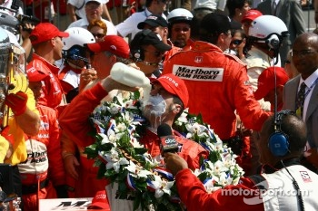Race winner Sam Hornish Jr.drinks the traditional Indy 500 winners' milk