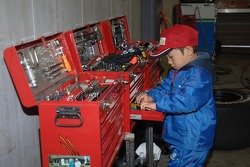 A young fan checks out the tools