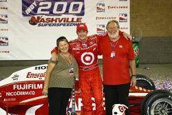 Victory lane: race winner Scott Dixon celebrates with his parents