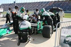 Vision Racing crew members work on the car of Ed Carpenter