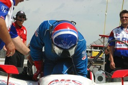 Al Unser Jr. climbs in his car to practice