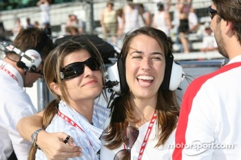 Helio Castroneves' fiancee Ali Vasquez and his sister, Kati Castroneves, celebrate as Helio Castroneves wins the pole