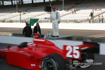 Honorary starter 1963 Indianapolis 500 winner Parnelli Jones waves the green flag