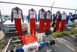 Firesuits dry up in the sun after a rainy evening