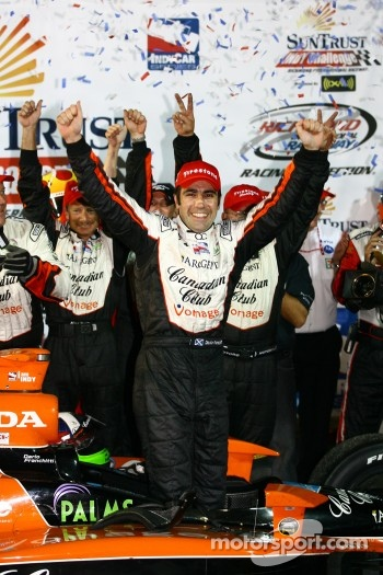 Winners circle: Dario Franchitti celebrates