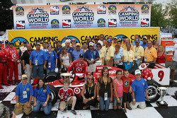 Winners circle: Scott Dixon poses for photographers