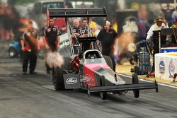 waves of heat and wrinkled tires on a top fuel leaving the line