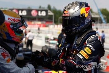 Sebastian Vettel, Red Bull Racing, celebrates victory in parc ferme with second place Lewis Hamilton, McLaren Mercedes