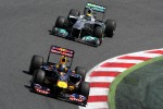 Sebastian Vettel, Red Bull Racing leads Nico Rosberg, Mercedes GP Petronas F1 Team
