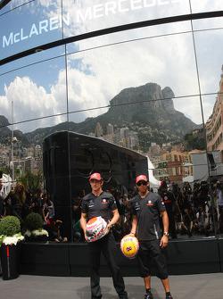 Jenson Button, McLaren Mercedes and Lewis Hamilton, McLaren Mercedes with Steinmetz Diamonds on their helmets