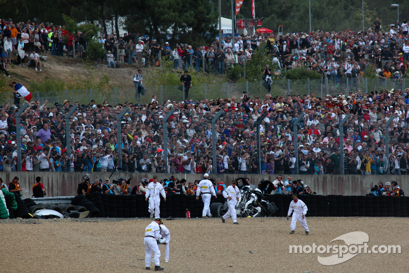 The scene after the crash of Allan McNish in the #3 Audi Sport North America Audi R18 TDI