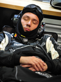 A Signatech-Nissan mechanic sleeps in the early hours