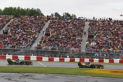 Jarno Trulli, Team Lotus leads Heikki Kovalainen, Team Lotus