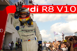 Race winner Timo Bernhard celebrates in parc ferme