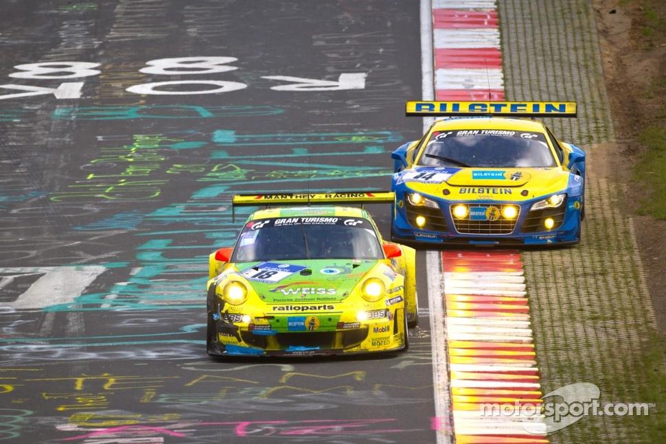 #18 Manthey Racing Porsche 911 GT3 RSR: Marc Lieb, Lucas Luhr, Romain Dumas, Timo Bernhard and #14 Audi Sport Team Phoenix Audi R8LMS: Marc Basseng, Marcel Fässler, Frank Stippler battle