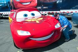 Cars creator John Lasseter posing with his creations