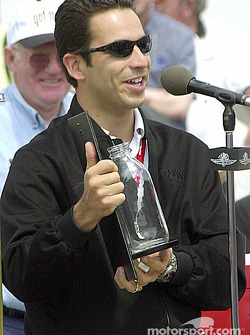 Castroneves accepts the Milk Board trophy