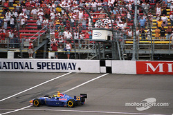 Tomas Scheckter taking the checkered flag