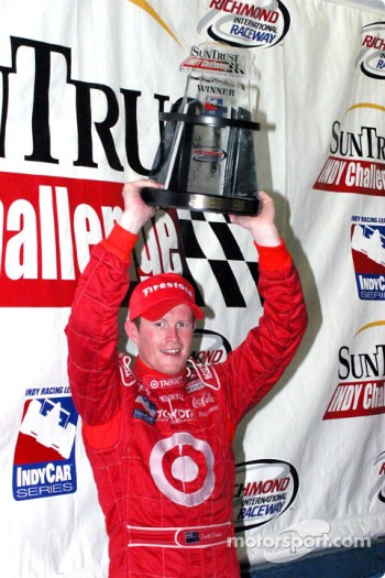 Scott Dixon proudly displays his trophy