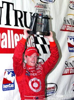 Scott Dixon proudly displays his trophy