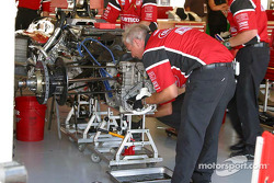 Kelley Racing crew members work on Toyota engine