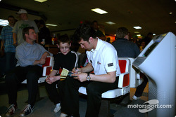 Sam Hornish Jr. at PBA Pro-Am in Indianapolis: Sam Hornish Jr. takes time to sign an autograph for a young fan