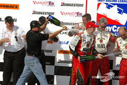 Champagne for Michael Andretti and Dan Wheldon