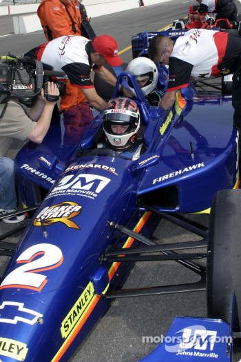 Sarah Fisher takes a guest in the Indy Racing League 2-seater car
