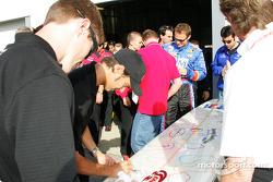 Darren Manning signs a surfboard