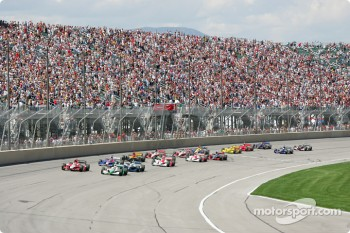 Green flag: Tony Kanaan and Dan Wheldon battle for the lead