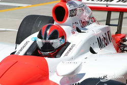 Helio Castroneves prepares to practice