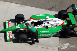 Andretti Green Racing crew members push car on pitlane