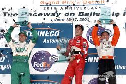 The podium: Dario Franchitti, Helio Castroneves and Roberto Moreno