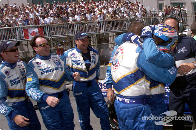 Alex Tagliani and Team Player's celebrating