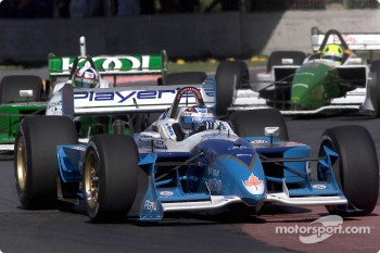 Alex Tagliani leading Dario Franchitti and Christian Fittipaldi