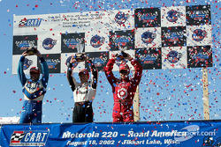 The podium: race winner Cristiano da Matta with Alex Tagliani and Bruno Junqueira