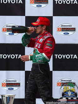 The podium: champagne for Adrian Fernandez