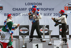 The podium: champagne for race winner Sébastien Bourdais with Bruno Junqueira and Mario Dominguez