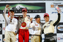 The podium: race winner Sébastien Bourdais with Paul Newman, Carl Haas and Bruno Junqueira