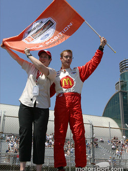 Pole winner Sébastien Bourdais celebrates with the flag
