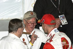 Paul Newman and Carl Haas congratulate Sébastien Bourdais