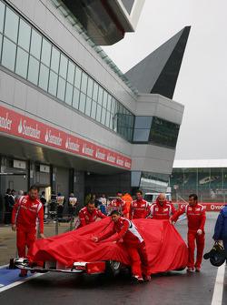Ferrari Mechanics pushing the car down to Parc Ferme