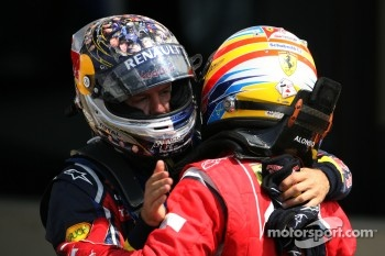 Second place Sebastian Vettel, Red Bull Racing, race winner Fernando Alonso, Scuderia Ferrari