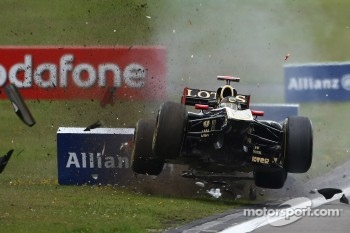 Heidfeld flies through the air after being hit by Buemi
