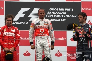 Podium: race winner Lewis Hamilton, McLaren Mercedes, second place Fernando Alonso, Scuderia Ferrari, third place Mark Webber, Red Bull Racing