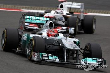 Michael Schumacher, Mercedes GP F1 Team leads Kamui Kobayashi, Sauber F1 Team