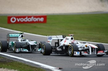 Nico Rosberg, Mercedes GP F1 Team and Kamui Kobayashi, Sauber F1 Team