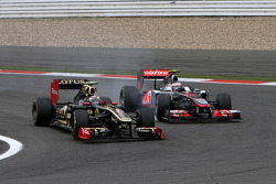 Vitaly Petrov, Lotus Renalut F1 Team and Jenson Button, McLaren Mercedes